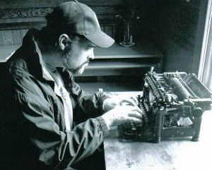 writer at work at typewriter