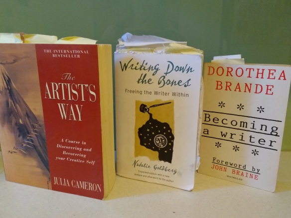 three book covers: The Artist's Way, Writing Down the Bones, Becoming a writer