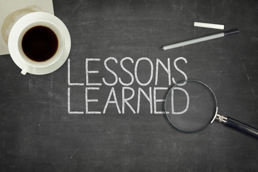Lessons learned concept on black blackboard