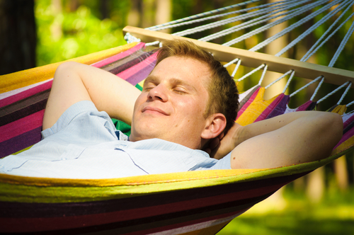 Young man sleeping in a hammock
